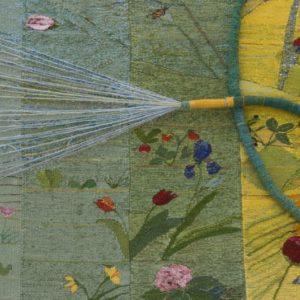 6-The Gardener's Year-detail on the garden hose